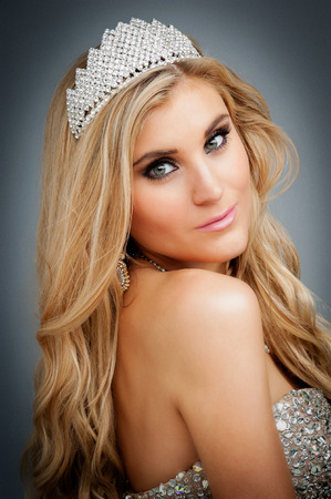 Woman wearing a tiara and ball gown  Studio shot  photo