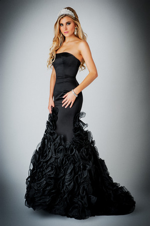 Glamourous woman wearing a tiara and ball gown photo