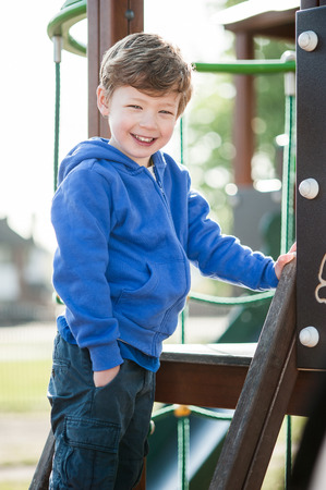 Gorgeous little boy playing in play ground. photo