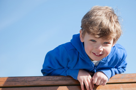 Happy toddler boy looking down to camera. Stock Photo