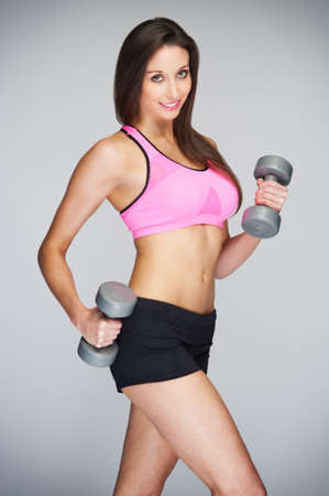 Fitness women with silver dumbell weights. Stock Photo