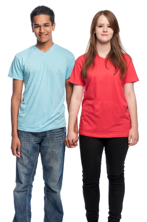 afro caribbean ethnicity: Happy boy and girl holding hands and smiling at camera. Studio shot on white background.