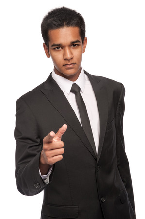 afro caribbean ethnicity: Young man in suit and looking angry and accusing. Studio white background. Stock Photo