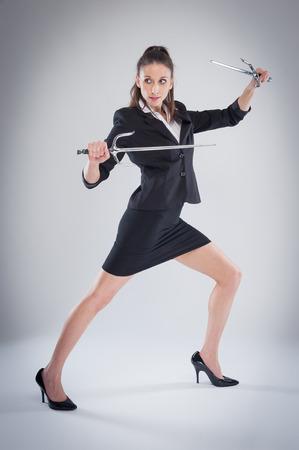 Woman in black suit means business. Archivio Fotografico