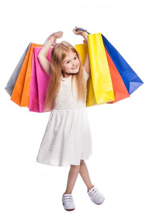Young child excited with shopping bags. Stock Photo