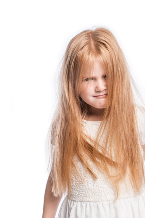 Young girl making a funny face with lots of hair in studio on white background. Stock Photo