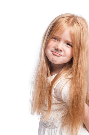 Silly face with lots of hair on young girl in studio shot on white background.