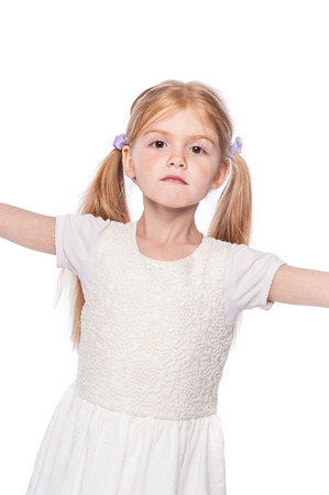 Striking pose young girl looking straight at camera in studio on white background. Stock Photo
