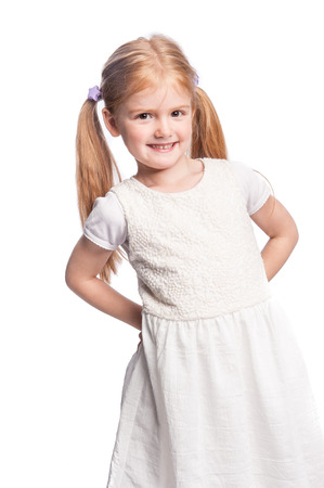 five year: Four five year year old girl smiling in studio portrait.