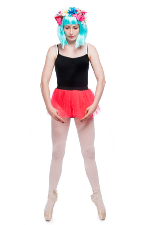 Pointe ballet position with crazy girl in vibrant wig.