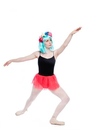 Mad crazy girl with arms out stretched in ballet tutu and leotard. Standard-Bild