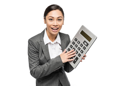 Chinese Asian woman with big calculator shot in studio on white background.