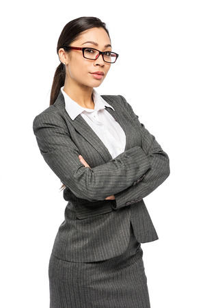 Intelligent looking executive woman in suit and glasses. Studio shot on white background.