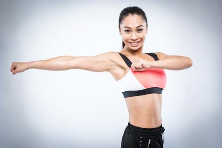 Stretch workout excersie girl shot in studio.