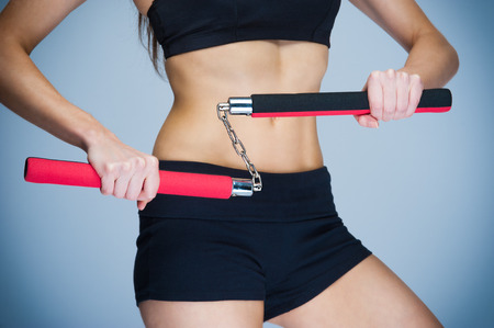 self defence: Fit woman training for self defence. Karate fitness workout. Stock Photo