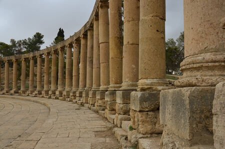 1st century: The massive 80m x 90m oval plaza, surrounded by a colonnade of 1st century Ionic columns   Jerash, Jordan  Stock Photo