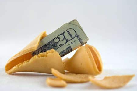 A fortune cookie with a twenty dollar bill inside Stock Photo - 5137183