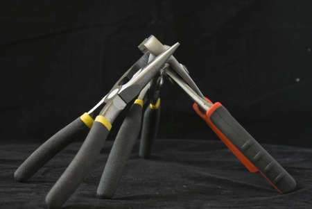 A group of pliers that look like they are fighting Archivio Fotografico