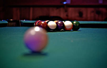 Perspective shot of billiard balls on a green pool table photo