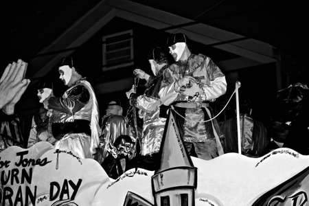 a black and white photo of riders with beads on a float during Mardi Gras in New Orleans Stock Photo - 9868296