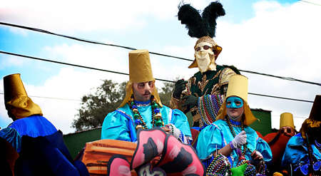 louisiana: Masked riders with beads on a float during Mardi Gras in New Orleans