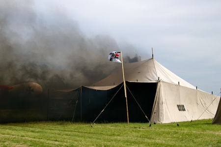 reenactment re enactment: Burning army tent from world war  Stock Photo