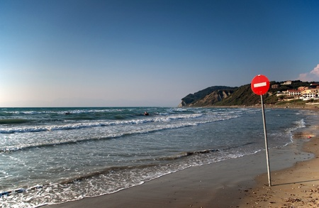 One way sign on the beach photo