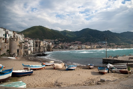 Beach in Cefalu, popular touristic village at the island of Sicily in Italy  photo