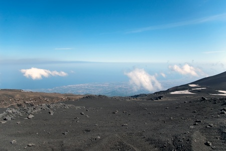 View from mount Etna with sea and towns beneath, Sicily, Italy Stock Photo