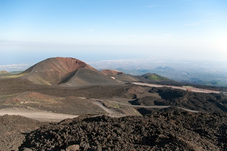 Two craters on the base of mt. Etna with sea and towns beneath, Lipari, Sicily, Italy Stock Photo