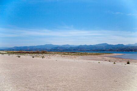 Deserted beach with mountains at background, Tindari gulf, Sicily, Italy Stock Photo