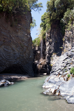 Alcantara river flowing in the unique rock canyon, Sicily, Italy photo