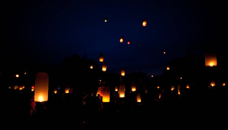 Night mass launch of Thai lanterns of luck photo