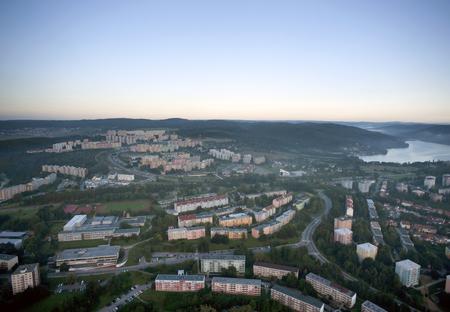Aerial city view with crossroads, roads, houses, parks, parking lots, bridges, Brno, Czech Republic
