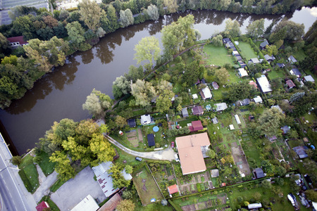 Highly detailed aerial city view with houses, gardens, river, Brno, Czech Republic