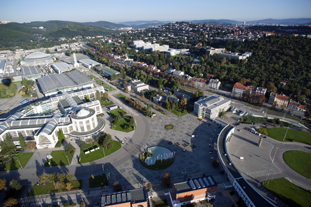 Highly detailed aerial city view with crossroads, roads, factories, houses, parks, parking lots, exhibition grounds, Brno, Czech Republic photo