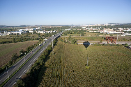 Highly detailed aerial city view with crossroads, roads, railroads, factories, houses, parks, parking lots, bridges and balloon shade, Brno, Czech Republic
