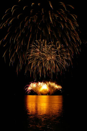 Colorful fireworks with water reflection  photo