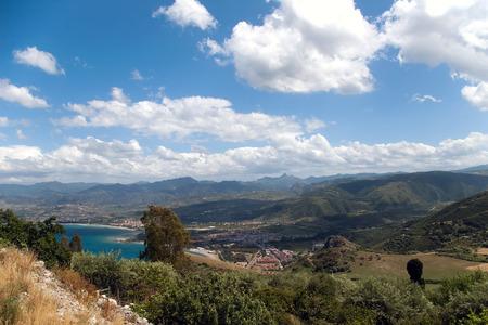 Tindari beach and waterfront, small village beneath mountains, Sicily, Italy  photo