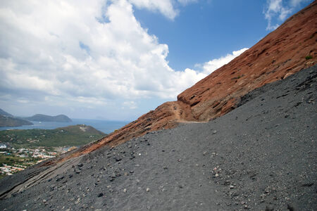 Black and red slope of the Vulcano volcano, Sicily photo