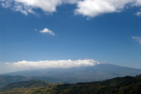Beautiful valley of the sicilian hinterland under the majestic volcano Etna  photo