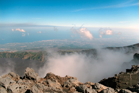 strange mountain: View from mount Etna with sea and towns beneath, Sicily, Italy Stock Photo