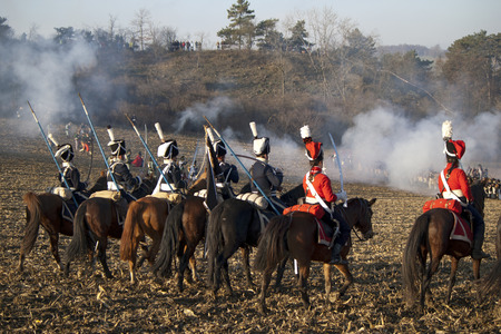 reenact: TVAROZNA, CZECH REPUBLIC - NOVEMBER 28: History fans in military costumes reenact the battle of Austerlitz, which Napoleon won in 1805, on November 28, 2009 near the village of Tvarozna, Czech Repuplic.