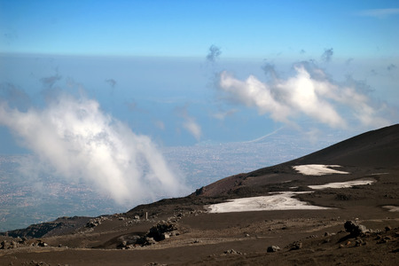 View from mount Etna with sea and towns beneath, Sicily, Italy photo