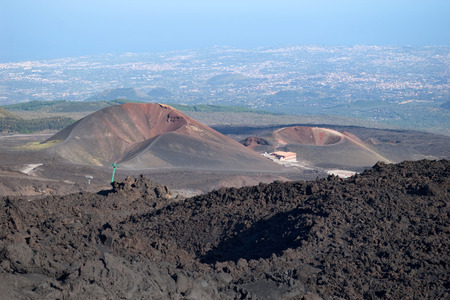 Two craters on the base of mt. Etna with sea and towns beneath, Lipari, Sicily, Italy photo