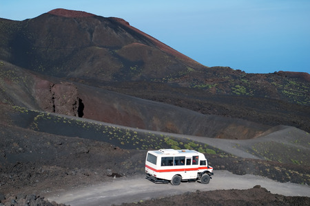 Road to Etna volcano with minibus, Sicily, Italy Stock Photo