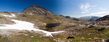 besseggen: Panoramic photo of Besseggen Ridge in Jotunheimen National Park, Norway Stock Photo