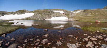Panoramic photo of Besseggen Ridge in Jotunheimen National Park, Norway Stock Photo
