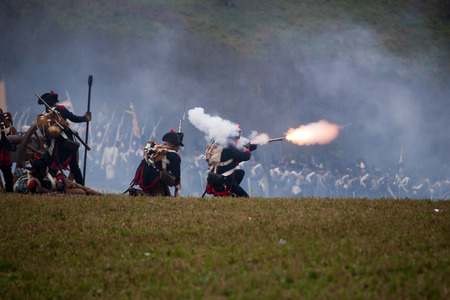 emanating: Soldier with fire emanating from the barrel of his rifle, Battle of Three Emperors, Austerlitz, Tvarozna, Czech republic Editorial