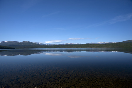 snow covered mountains: Tranquil lake with snow covered mountains, Norway